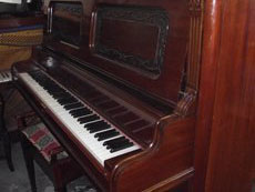 Old brown piano