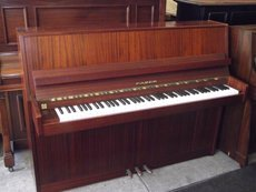 New brown wooden piano