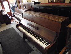 Small open wooden piano