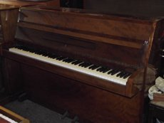 Small brown piano