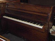 Small brown piano