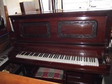 old wooden piano